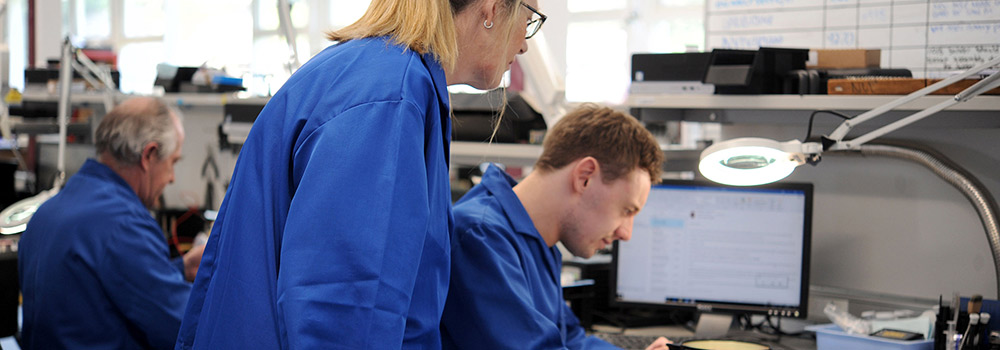 Photo of people in a laboratory working at a desk